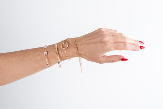 Detail of many several bracelet on woman Hand arm Model