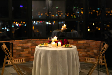 Fototapeta Served Table With Food And Burning Candles In Restaurant Interior obraz
