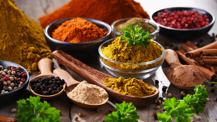 Variety of spices on kitchen table Wall mural