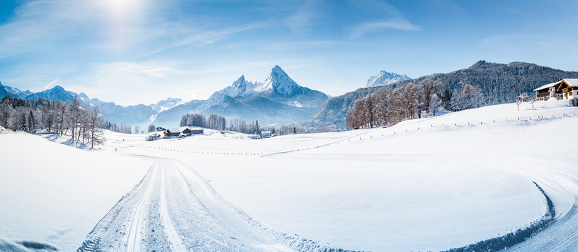 Winter wonderland scenery with cross-country skiing track in the Alps