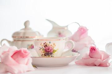 A set of  floral rose pattern fine china porcelain tea set with a tea-pot, sugar pot, creamer, and tea cup