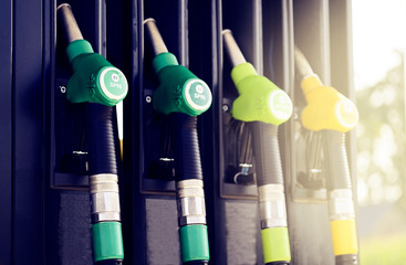 Close-up fuel nozzles on petrol and diesel fuel staying put into a gasoline pump.  Fototapete