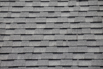 Roof shingles background and texture. grey and black asphalt tile of house roof.