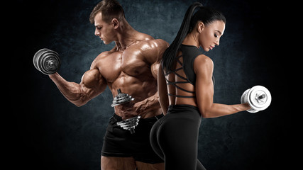 Poster Fitness Sporty couple workout with dumbbells. Muscular man and woman showing muscles
