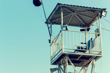 The top of a rescue post, rescue tower on the beach.