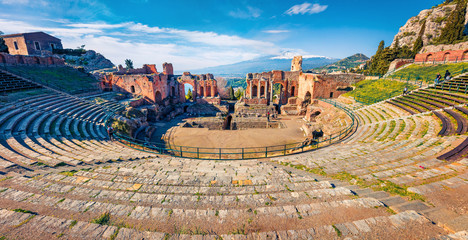 Panoramic morning view of Taormina town and Etna volcano on background. Picturesque spring view of ancient Greco-Roman theater, Sicily, Italy, Europe. Traveling concept background. Fototapete