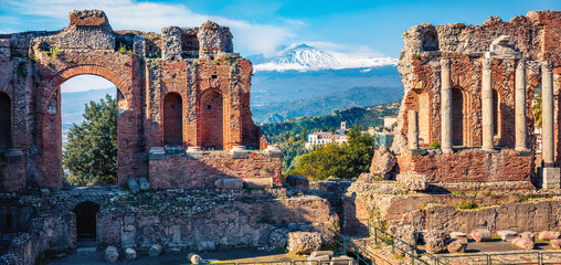 Panoramic morning view of Taormina town and Etna volcano on background. Splendid spring scene of ancient Greco-Roman theater, Sicily, Itale, Europe. Traveling concept background. Wall mural