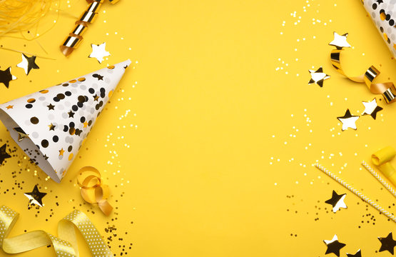 Flat lay composition with birthday decor on yellow background. Space for text