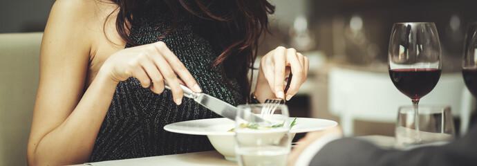 WOman having dinner in a luxury restaurant - detail Fototapete