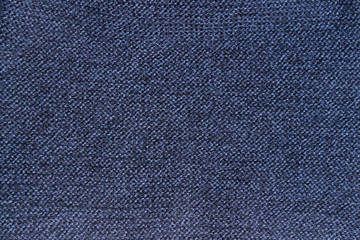 Texture of blue knitted woolen or knitted fabric.