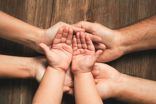 Three hands of family. Love, togetherness, happiness in family concept.