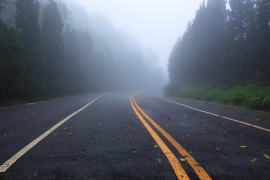Country road with foggy at Thailand