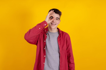 young teenage man or student isolated on color background