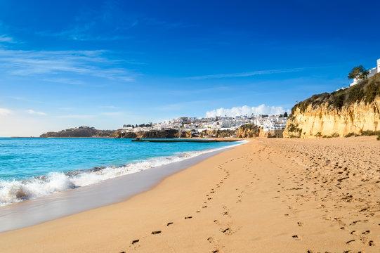 Sandy beach in Albufeira resort village in Algarve, Portugal.