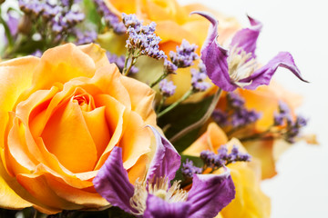 Yellow roses and purple clematis