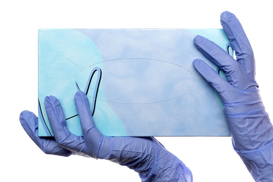 hands in latex medical gloves holding a box of mockup