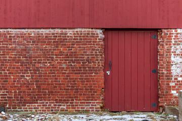 red wooden door brick wall