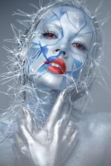 Obraz Beautiful girl in an unusual winter look with red lips. Creative make- up. Art look. - fototapety do salonu