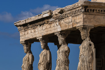 The Erechtheion (or Erechtheum, 406 BC) with Caryatids - ancient Greek temple on the north side of the Acropolis. Erechtheion dedicated to both Athena and Poseidon. Athens, Greece. Fotomurales