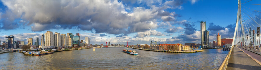 Cityscape, panorama, banner - view from the Erasmus Bridge to the River Maas and the City of Rotterdam, The Netherlands
