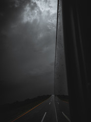 Rain drops on the mirror and light comes out from the darkness Traveling Photography