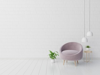 Living room with pink fabric armchair, book and plants on empty white wall background.