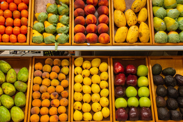 Traditional Mexican fruit marketplace display at colored market street