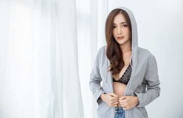 Portrait of young beautiful asian sexy woman wearing bra hooded. Smile happy asian girl with perfect clear glow skin face. Lifestyle people beauty girl next door concept