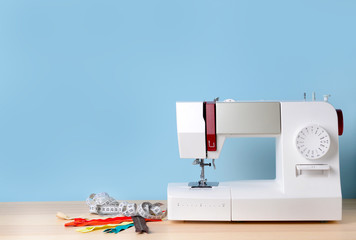 Sewing machine with supplies on table