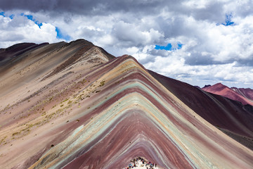 Poster Close-up view of Rainbow Mountains Of Peru Peruvian Andes. Ausangate mountain. Bright colors and beautiful clouds.