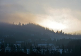 evening light with fog on the mountains