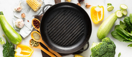 World vegan day concept. Empty grill pan with fresh vegetarian various ingredients for cooking vegan grilled food top view