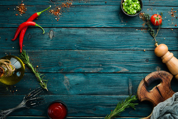 Blue wooden background of cooking. Top view. Free space for your text.