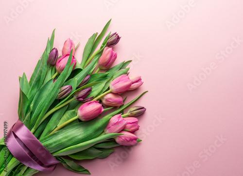 Bouquet pink tulips on lightpink background.