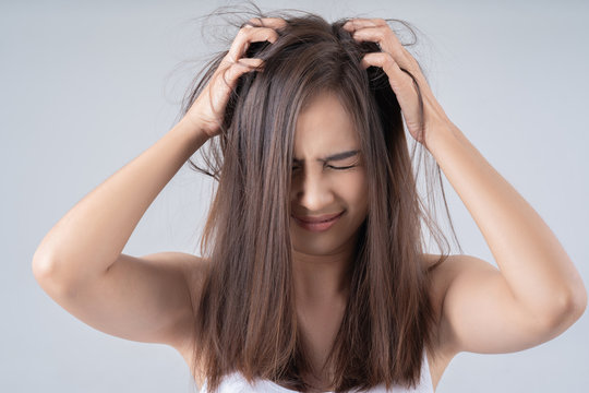 Asian woman. She is shocked at the damaged hair.