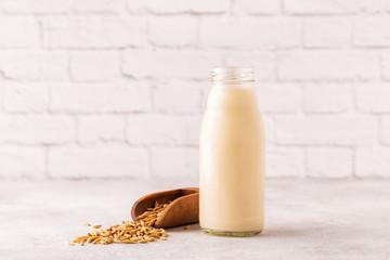 A bottle of oat milk and oats.