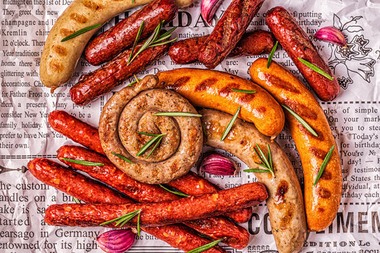 Homemade sausages grilled on a newspaper.