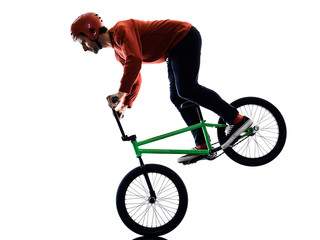one young caucasian man BMX rider cyclist cycling freestyle acrobatic stunt in studio isolated on white background Wall mural