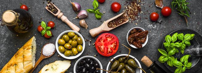 Mediterranean food background. Cooking ingredients on dark stone. Papier Peint