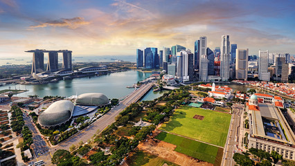 Poster de jardin Singapoure Singapore city panoranora at sunrise with Marina bay