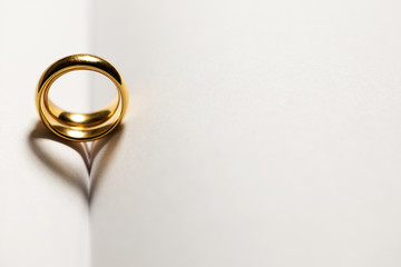 Golden wedding rings on book