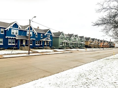 line of townhouses in winter snow
