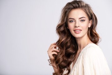 Portrait of a beautiful smiling  woman with a long hair. Fotomurales