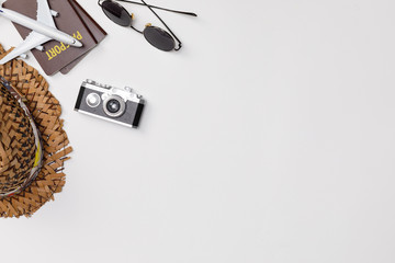 Top view mockup of Traveler's accessories with passport, camera, hat  and airplane toy isolated...