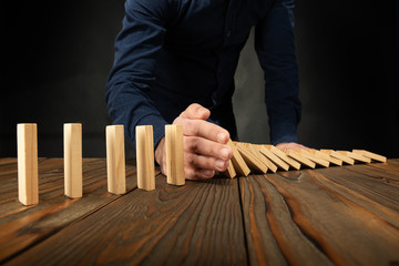 Protecting Assets From Domino Effect. Stop Loss Concept.