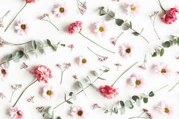 Poster Bloemen Flowers composition. Pattern made of pink flowers and eucalyptus branches on white background. Valentines day, mothers day, womens day concept. Flat lay, top view