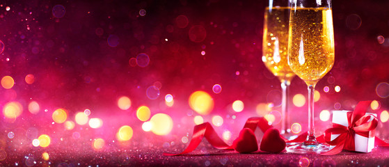 Wall Mural - Valentines Celebration With Champagne - Flutes With Defocused Lights In Red Shiny Background