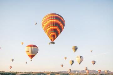 Poster Ballon Colorful hot air balloons flying over the valley in Cappadocia, Turkey