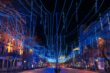 Beautiful night Madrid street with blue illumination over empty road and historical buildings Fotomurales
