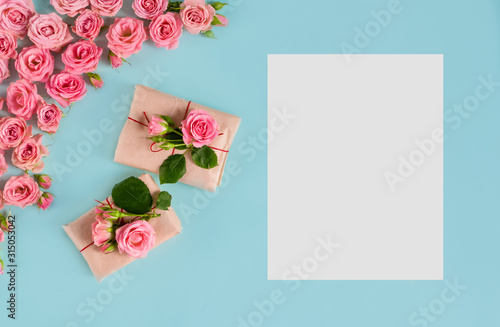 Valentine's day banner greeting card with gifts and pink roses on a blue background.Women's day.Mother's day.love.copyspace